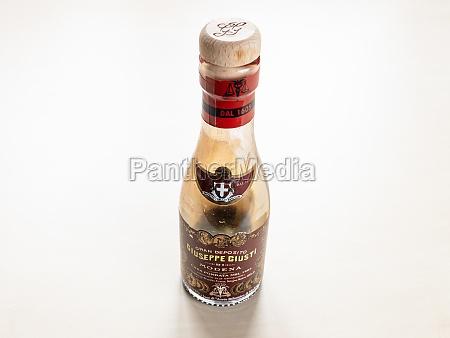 used glass bottle of aged giusti