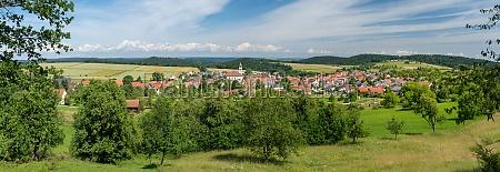 idyllic village panorama in hilly rural