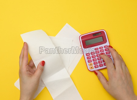 two female hands hold paper checks