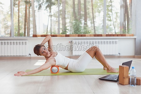 sporty woman doing online exercises with