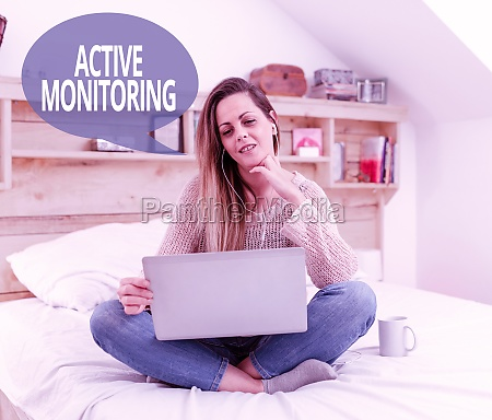 hand writing sign active monitoring business