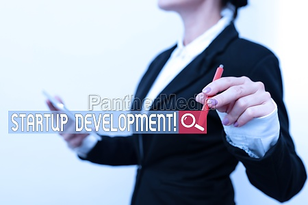 hand writing sign startup development business