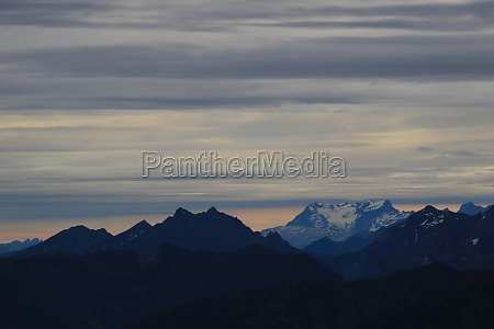 grey clouds over mount titlis and