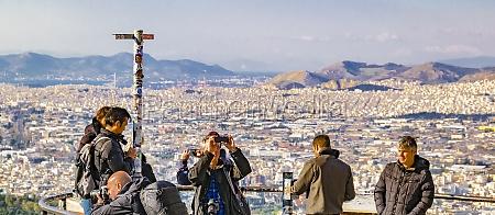 tourists taking photos lycabettus hill athens