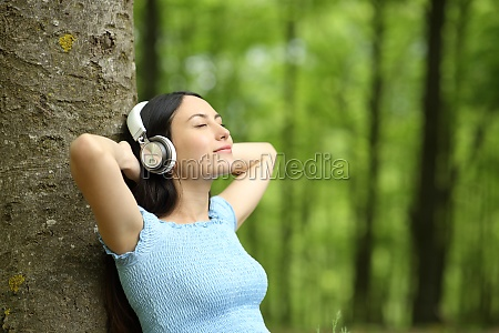 asian woman resting listening to music