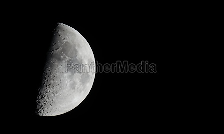half moon seen with telescope