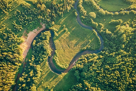 fields and small narrow winding river