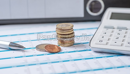 coins on documents with a calculator