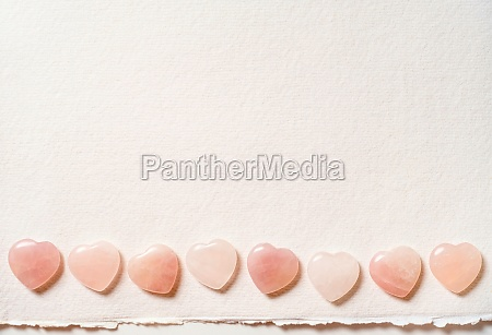 glass hearts on white background