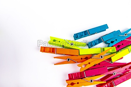 colored clothespins on a white background