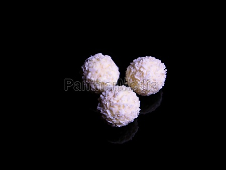 round white candy with coconut flakes