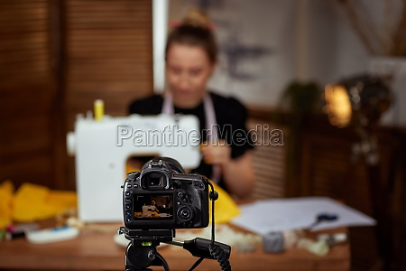 seamstress blogger shooting with camera for