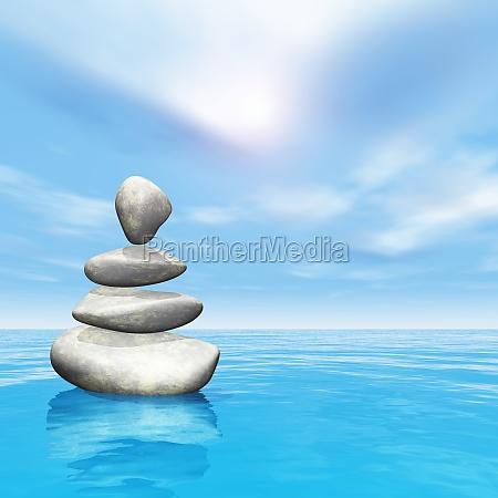 3d balancing pebbles in ocean