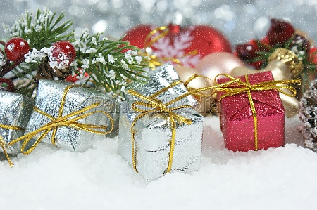 christmas gifts and pine tree branch