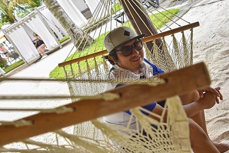 mexican boy in the hammock