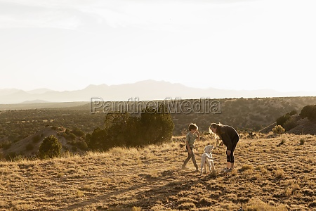 children at sunset playing with their