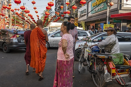 buddhist monks on busy street in
