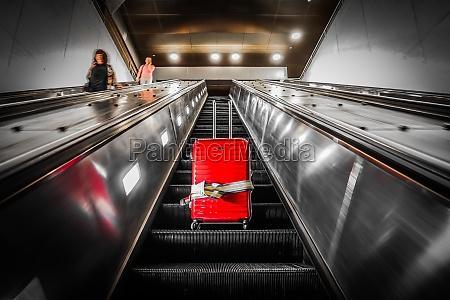 escalator and suitcase