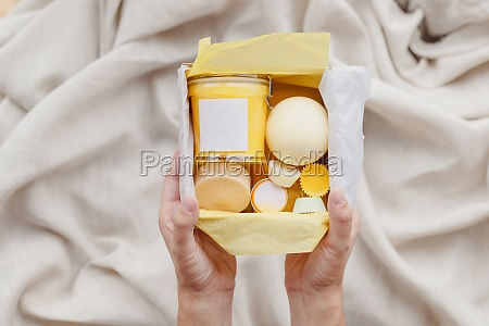 female hands hold care box set