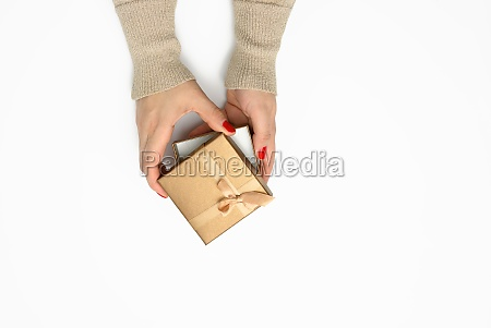two female hands holding a square