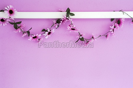 cheerful colorful pink purple daisies garland