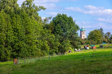 rural country scene with church tower