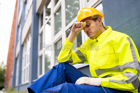 upset sad construction worker