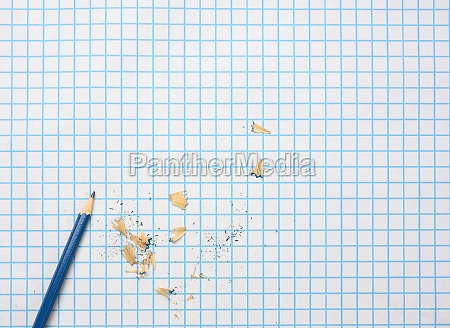 sharpened wooden pencil with shavings on
