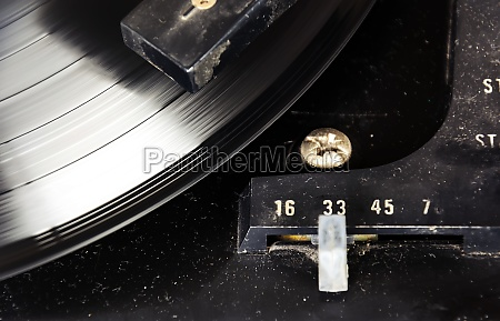 black vinyl record spinning on the