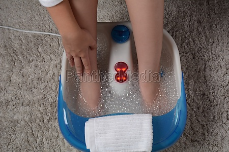 female feet in a vibrating foot