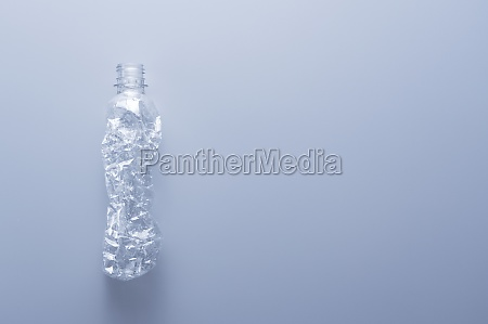 a crushed plastic bottle on a