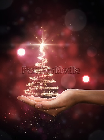 red christmas tree in hand
