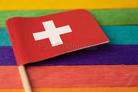 switzerland flag on rainbow background symbol