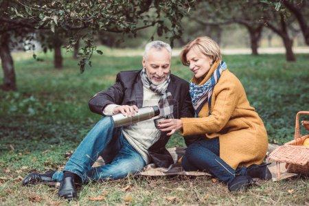 beautiful, holding, love, female, sitting, grass - B129048412